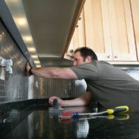 man-remodeling-kitchen